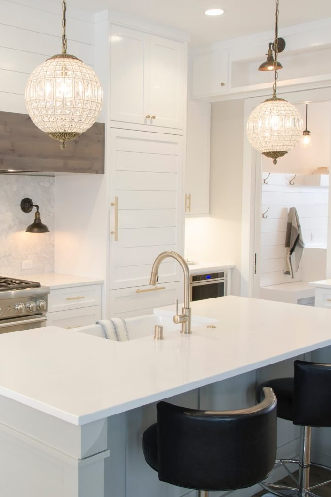kitchen inspiration - This kitchen uses light to turn a neutrual black and white colour scheme to something with a hint of warmth, which is also mimicked with the brushed gold accents.  A great idea using the lighting to change the feel #modern #kitchen #inspiration